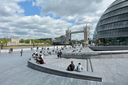 southbank: LONDON -  MAY 14 2015:The Queens South Bank Walk London.Its a sightseeing walk for tourists and visitors that follows the River Thames Southbank path from Westminster Bridge to the Tower Bridge. Editorial
