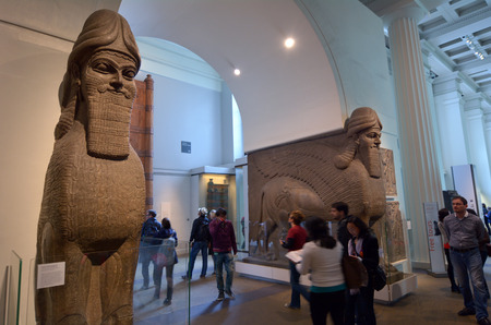 british museum: LONDON - MAY 15 2015:Visitors in the British Museum.The Museum contain almost 71,000 books, manuscripts, drawings, prints and antiques taken from Greece, Rome, Egypt, and many different countries.