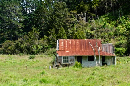 Old deserted wooden farm house in Northland New Zealand.