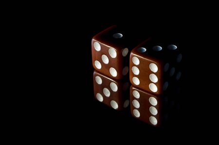 copy text: Casino dice on a black background with copy text space. Stock Photo
