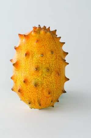 hedged: Kiwano or African horned melon over white background. Also known as hedged gourd, African Horned Cucumber, English tomato.