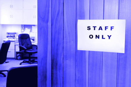 staff only: A sign reads Staff only in a office door.