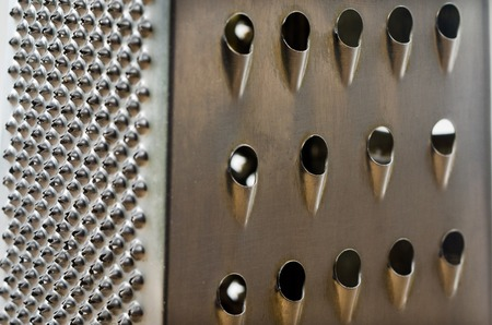 metal grater: Closeup photo of a stainless steel metal grater. Stock Photo