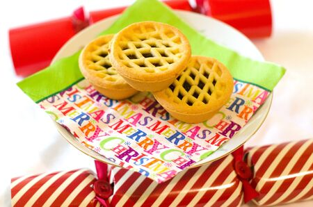 christmas cracker: Traditional Christmas fruit cakes and crackers during Xmas day. Stock Photo