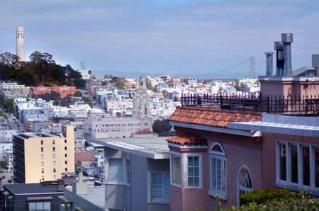 telegraph hill: Coit Tower as view from Lombard Street at dusk in San Francisco, California. Stock Photo