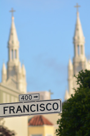 saints peter and paul: Francisco street sign against the bells towers of Saints Peter and Paul Church in San Francisco California Stock Photo