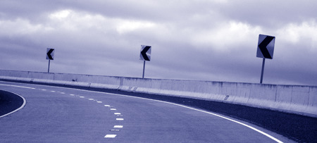 dangerous road: Dangerous road curve left turn in a stormy day. concept photo