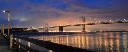bay bridge: Oakland Bay Bridge lights in dusk in San Francisco, California.