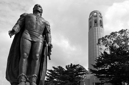 coit: Coit Tower with statue of Columbus in foreground in San Francisco, California.