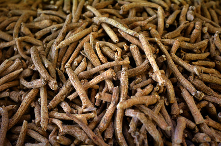 ginseng roots: Dry Asian Ginseng Roots at the market in Chinatown. Food background texture.