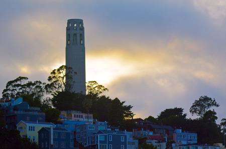 Coit Tower as view from Oakland Bay Bridge at dusk in San Francisco, California. Stock Photo