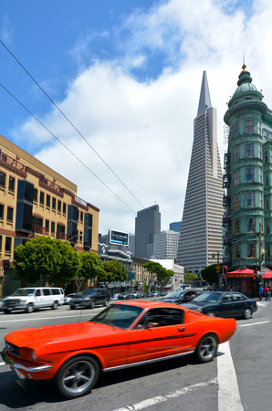 transamerica: SAN FRANCISCO - MAY 18 2015:Traffic under Transamerica Pyramid in San Francisco, CA.Its Business tenants include Bank of America Merrill Lynch, ATEL Capital Group, Rembrandt Venture Partners, and more. Editorial