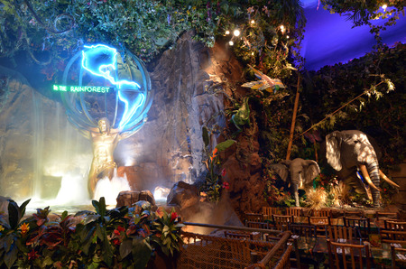 depict: SAN FRANCISCO, USA - MAY 21 2015:Rainforest Cafe in San Francisco,CA.Its a themed restaurant chain owned by Landrys, Inc. Each restaurant is designed to depict some features of a tropical rainforest