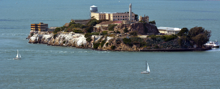 notorious: SAN FRANCISCO - MAY 18 2015:Aerial view of Alcatraz Island in San Francisco Bay. Its mostly known as the home to the most secure prison held some of the most notorious criminals in American history.