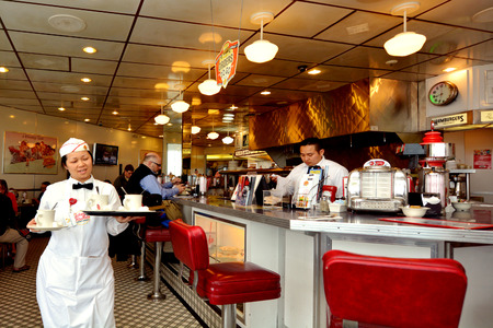 diner: SAN FRANCISCO - MAY 17 2015:Classic American Diner in San Francisco,CA.Diners are popular American urban culture open 247 and serve American food such as hamburgers, french fries and club sandwiches.
