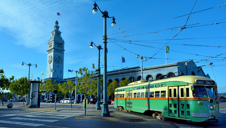SAN FRANCISCO - MAY 15 2015:One of San Francisco's original PCC streetcars in SF Ferry Building. itÕs one of the most expensive urban transit system to operate in America, costing about  $25 per train Stok Fotoğraf - 43111721