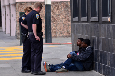 SAN FRANCISCO - MAY 15 2015:SFPD officers interrogating black american men in San Francisco.Overall, Black Americans are arrested at 2.6 times the per-capita rate of all other Americans.