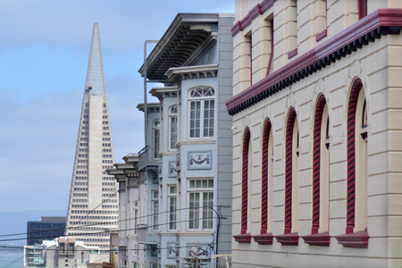 transamerica: SAN FRANCISCO - MAY 21 2015:Transamerica Pyramid with old buildings in San Francisco downtown. The Transamerica Pyramid is the tallest skyscraper in the San Francisco skyline.