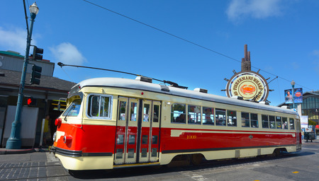 streetcar: SAN FRANCISCO - MAY 15 2015:One of San Franciscos original double-ended PCC streetcars in Fisherman Market.The PCC car is icon of streetcar design and some are still in service around the world. Editorial