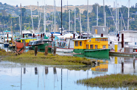 north end: SAN FRANCISCO - MAY 21 2015:Colorful houseboats in Sausalito California.Sausalito houseboat community consists of more than 400 houseboats of various shapes, sizes and values at the north end of town.