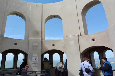 coit: SAN FRANCISCO - MAY 18 2015:Visitors at Coit Tower mural rotunda in San Francisco California.Coit Tower listed as San Francisco Designated Landmark and on the National Register of Historic Places.