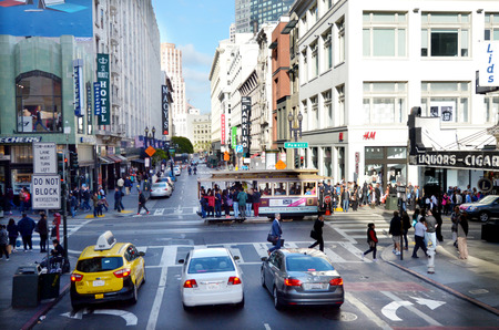 about: SAN FRANCISCO - MAY 15 2015:Traffic on Powell Street.San Fransisco has a density of about 18,187 people per square mile (7,022 people per km2), making it the most densely large city in California