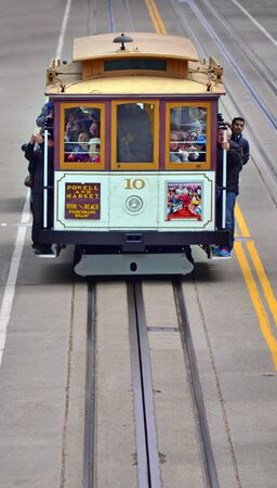 7 months: SAN FRANCISCO - MAY 19 2015:Passengers riding on cable car on steep hill in San Francisco, CA.By 1979, the cable car system had become unsafe, and closed for 7 months for urgently needed repairs