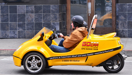 see the usa: SAN FRANCISCO, USA - MAY 19 2015:Tourists drive a GoCar in San Francisco, California. The GoCars were created with the purpose of being rented to tourists as a different way to see a city.