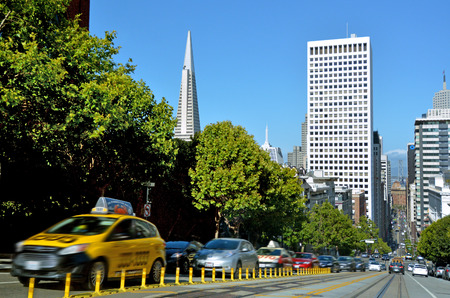transamerica: SAN FRANCISCO - MAY 16 2015:Traffic on California Street in Financial District of San Francisco.Tourism is one of the citys largest private-sector industries, accounting for more than 1 out of 7 jobs Editorial
