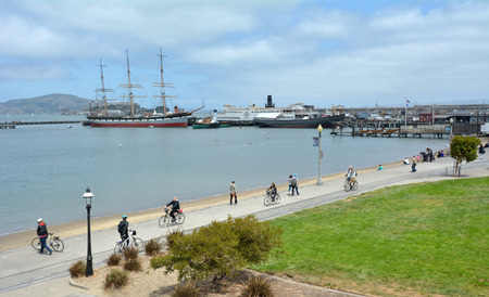francisco: SAN FRANCISCO - MAY 17 2015:Aerial view of Hyde Street Pier in Fishermans Wharf. The park includes a fleet of historic vessels, a visitor center, a maritime museum, and a libraryresearch facility.