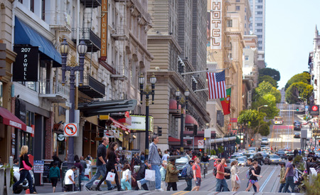 san: SAN FRANCISCO - MAY 15 2015:Traffic in San Francisco. It has a density of about 18,187 people per square mile (7,022 people per km2), making it the most densely settled large city in California