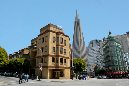 transamerica: SAN FRANCISCO - MAY 18 2015:Visitors under Transamerica Pyramid in San Francisco Financial district.Only two of the buildings 18 elevators reach the top floor. Editorial