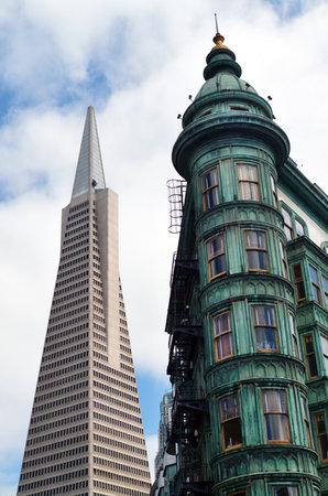 transamerica: SAN FRANCISCO - MAY 15 2015:Columbus Tower Sentinel Building and Transamerica Pyramid in San Francisco CA.The distinctive copper-green Flatiron style structure is a San Francisco designated landmark. Editorial