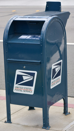 SAN FRANCISCO, USA - MAY 20 2015:United States Postal Service postal box.In 2014, the Postal Service collected $67.8 billion in revenue Editorial