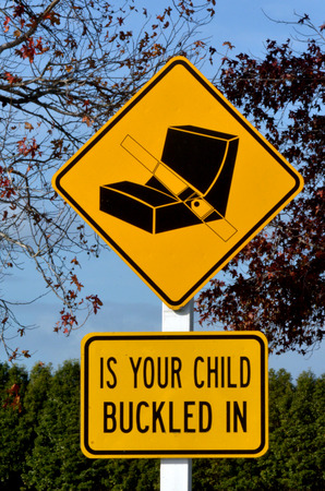 buckled: Is your child buckled in warning traffic sign and symbol. concept