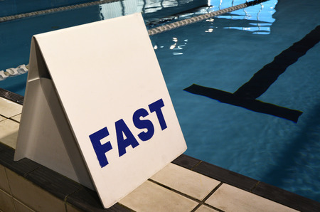 fast lane: Fast lane sign in swimming pool. concepts and ideas