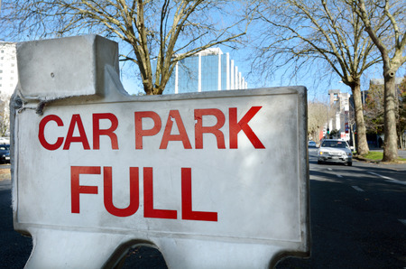 carpark: AUCKLAND - JULY 21 2015:Car park full sign in the city center of Auckland, New Zealand.There is a growing shortage of car park spaces in the Auckland CBD. Approximately 800 car parks have gone since 2007. Editorial