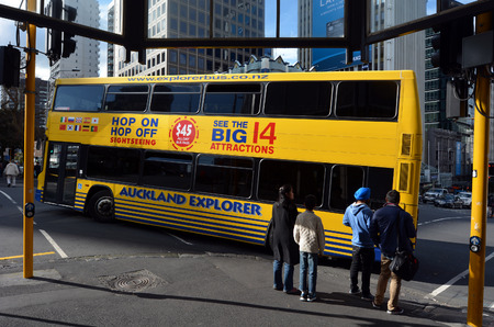 sightseeing tour: AUCKLAND - AUG 08 2015:Auckland Hop On Hop Off Explorer tour bus. It is a popular all day sightseeing tour bus visiting Aucklands Big 14 Attractions with full commentary.