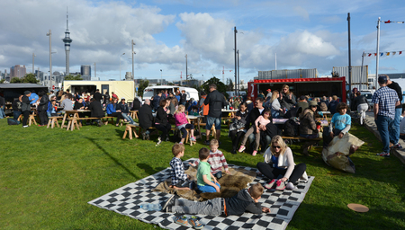 ranked: AUCKLAND - AUG 01 2015:Visitors having a picnic at Wynyard Quarter in Auckland Ne Zealand. In 2014 Auckland has again been ranked the tenth most liveable city in the world.