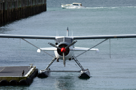 extreme weather: AUCKLAND - AUG 01 2015: Seaplane mooring in Aucklnad Viaduct Harbour.Seaplanes can only take off and land on water with little or no waves and have trouble in extreme weather.
