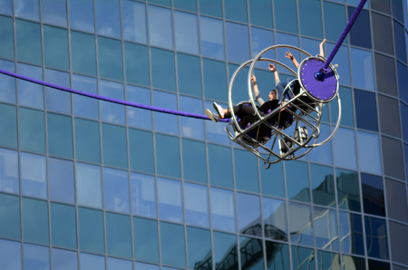 periods: AUCKLAND - AUG 01 2015:Sky Screamer Reverse Bungy in Auckland. Often riding the slingshot, riders may experience temporary periods of reduced consciousness, which may lead into greyouts or syncope. Editorial