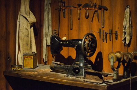 An old sewing machine in a workshop.