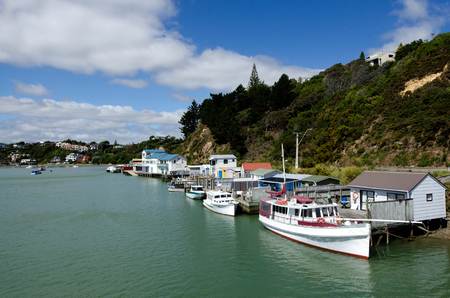 sheds: Motor boats and boat sheds at Paremata on Pauatahanui Inlet and harbour, Paremata, Porirua City District, Wellington Region, New Zealand (NZ)