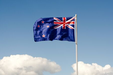 new zealand flag: New Zealand National flag wave above long white clouds.