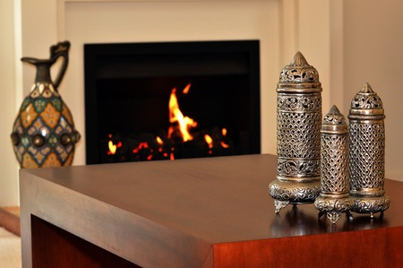 fireplace living room: Fireplace in a warm living room Stock Photo