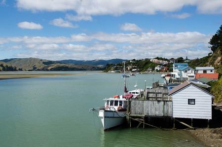 motor boats: Motor boats and boat sheds at Paremata on Pauatahanui Inlet and harbour, Paremata, Porirua City District, Wellington Region, New Zealand (NZ)