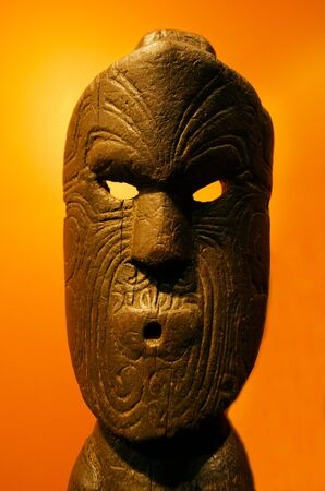 aotearoa: Ancient Maori Sculpture of human face mad out of wood.