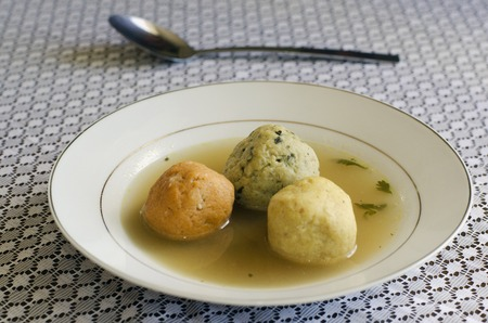 kneidl: Matzah balls in a bowl of soup Stock Photo