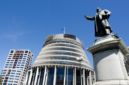 new building: The bronze statue of Richard John Seddon and the Beehive building - Parliament of New Zealand in Wellington city.