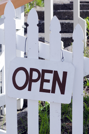 store sign: An open sign hanged outside a restaurant, store, office or other business (copy-space available for design)